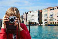 Young boy taking photographs, Venice, Italy Stock Photo - Premium Royalty-Freenull, Code: 649-07520751