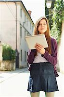 Girl with digital tablet on street, Province of Venice, Italy Stock Photo - Premium Royalty-Freenull, Code: 649-07520769
