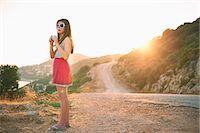 road landscape - Girl holding camera at sunset, Kas, Turkey Stock Photo - Premium Royalty-Freenull, Code: 649-07520777