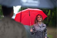 people with umbrellas in the rain - Young woman meeting man in park Stock Photo - Premium Royalty-Freenull, Code: 649-07520866