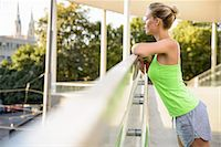 Young woman leaning on railing Stock Photo - Premium Royalty-Freenull, Code: 649-07521075