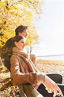 Couple sitting on bench Stock Photo - Premium Royalty-Freenull, Code: 649-07521115