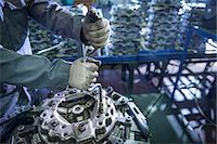 Close up of engineer assembling industrial clutch on production line Stock Photo - Premium Royalty-Freenull, Code: 649-07521189
