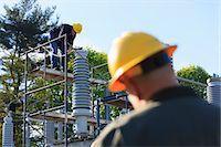 Power engineer performing maintenance on fluid filled high voltage insulator, Braintree, Massachusetts, USA Stock Photo - Premium Royalty-Freenull, Code: 6105-07521399