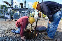 Power engineers placing ladder inside manhole at high voltage power distribution station, Braintree, Massachusetts, USA Stock Photo - Premium Royalty-Freenull, Code: 6105-07521409
