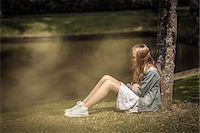 sad girls - Girl sitting under tree, Ronneby, Blekinge, Sweden Stock Photo - Premium Royalty-Freenull, Code: 6102-07521511