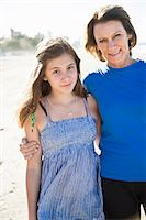 Mother with teenage daughter on beach Stock Photo - Premium Royalty-Freenull, Code: 6102-07521597
