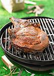 Beef chop on the barbecue outdoors