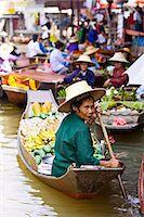 food stalls - Fruit seller in the Damnern Saduak floating market, Bangkok, Thailand Stock Photo - Premium Rights-Managednull, Code: 841-07523503