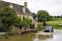 Four wheel drive car drives through flooded road in Swinbrook, Oxfordshire, England, United Kingdom Stock Photo - Premium Rights-Managed, Artist: Robert Harding Images, Code: 841-07523520