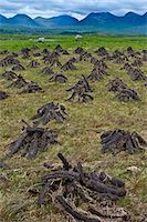 Stacked peat in turf bog on the Old Bog Road near Roundstone, Connemara, County Galway Stock Photo - Premium Rights-Managed, Artist: Robert Harding Images, Code: 841-07523779