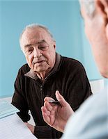 Senior male patient consulting doctor in office, Germany Stock Photo - Premium Rights-Managednull, Code: 700-07529228