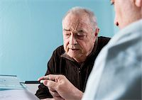 Senior male patient consulting doctor in office, Germany Stock Photo - Premium Rights-Managednull, Code: 700-07529229
