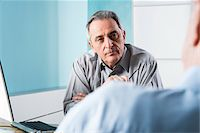Senior, male doctor conferring with male patient in office, Germany Stock Photo - Premium Rights-Managednull, Code: 700-07529236