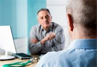 Senior, male doctor conferring with male patient in office, Germany Stock Photo - Premium Rights-Managednull, Code: 700-07529237