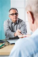 Senior, male doctor conferring with male patient in office, Germany Stock Photo - Premium Rights-Managednull, Code: 700-07529241