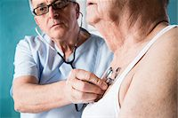 Senior, male doctor using stethoscope on senior, male patient, in office, Germany Stock Photo - Premium Rights-Managednull, Code: 700-07529243