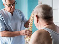 Senior, male doctor discussin spinal cord with senior, male patient, in office, Germany Stock Photo - Premium Rights-Managednull, Code: 700-07529247
