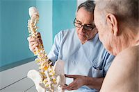 Senior, male doctor discussin spinal cord with senior, male patient, in office, Germany Stock Photo - Premium Rights-Managednull, Code: 700-07529249