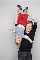 Mother holding baby boy upside down Stock Photo - Premium Royalty-Freenull, Code: 653-07539033