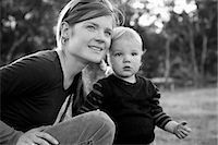 Mother with baby boy, looking away Stock Photo - Premium Royalty-Freenull, Code: 653-07539035