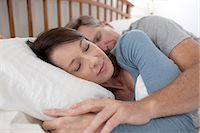 Middle aged woman and man sleeping in bed Stock Photo - Premium Royalty-Freenull, Code: 6106-07539241
