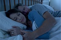 Middle aged woman and man sleeping in bed Stock Photo - Premium Royalty-Freenull, Code: 6106-07539242