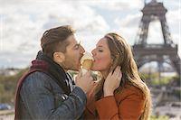 eating ice cream - Couple Eating Ice Cream in Paris Stock Photo - Premium Royalty-Freenull, Code: 6106-07539358