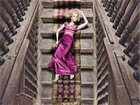 silky - Beautiful woman lying on a silk rug Stock Photo - Premium Royalty-Freenull, Code: 6106-07539413