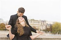 Well Dressed Loving Couple Stock Photo - Premium Royalty-Freenull, Code: 6106-07539455