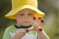farm and boys - Male toddler with raspberries on his fingers Stock Photo - Premium Royalty-Freenull, Code: 6106-07539461