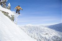 Snowboarder hucks cliff on sunny day Stock Photo - Premium Royalty-Freenull, Code: 6106-07539517