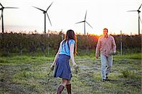Couple In Field, Wind Turbines In Background, Croatia, Europe Stock Photo - Premium Royalty-Freenull, Code: 6115-07539603