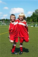 football team - Two boys at soccer training, side by side, Munich, Germany Stock Photo - Premium Royalty-Freenull, Code: 6115-07539643