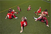football team - Group of boys at soccer training, stretching, Munich, Bavaria, Germany Stock Photo - Premium Royalty-Freenull, Code: 6115-07539644