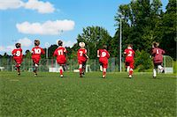 football team - Group of boys at soccer training, running side by side, Munich, Bavaria, Germany Stock Photo - Premium Royalty-Freenull, Code: 6115-07539647