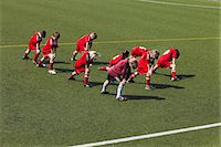 football team - Group of boys at soccer training, stretching, Munich, Bavaria, Germany Stock Photo - Premium Royalty-Freenull, Code: 6115-07539648