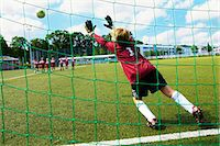 football team - Boys at soccer training, free kick, goal keeper in foreground, Munich, Bavaria, Germany Stock Photo - Premium Royalty-Freenull, Code: 6115-07539650