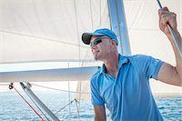 sailboat  ocean - Mature man on sailboat, looking away, Adriatic Sea, Croatia Stock Photo - Premium Royalty-Freenull, Code: 6115-07539700