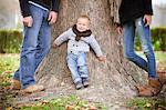 Family with son leaning against tree, Osijek, Croatia