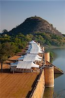 Chhatra Sagar reservoir and luxury tented camp oasis in the desert at Nimaj, Rajasthan, Northern India Stock Photo - Premium Rights-Managed, Artist: Robert Harding Images, Code: 841-07540461