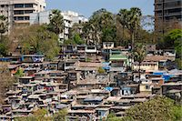 Slum housing and slum dwellers next to apartment blocks in Bandra area of Mumbai, India from Bandra Worli Sealink Road Stock Photo - Premium Rights-Managed, Artist: Robert Harding Images, Code: 841-07540473
