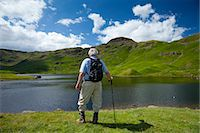 Tourist on nature trail in lakeland countryside at Easedale Tarn lake in the Lake District National Park, Cumbria, UK Stock Photo - Premium Rights-Managed, Artist: Robert Harding Images, Code: 841-07540509