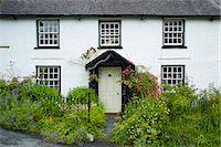 quaint house - Quaint lakeland cottage with studded front door and Welcome sign, at Troutbeck in the Lake District National Park, Cumbria, UK Stock Photo - Premium Rights-Managednull, Code: 841-07540543