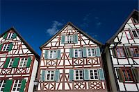 quaint house - Windows and wooden shutters of quaint timber-framed houses in Schiltach in the Bavarian Alps, Germany Stock Photo - Premium Rights-Managednull, Code: 841-07540667