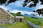Historic cottage of Dan O'Hara, evicted by the British and forced to emigrate, by Twelve Bens Mountains, Connemara, Ireland Stock Photo - Premium Rights-Managed, Artist: R