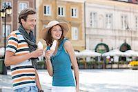 eating ice cream - Tourist couple enjoying ice cream cones during vacation Stock Photo - Premium Royalty-Freenull, Code: 693-07542197