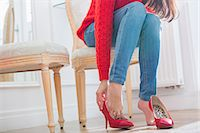 Low section of woman trying on footwear in store Stock Photo - Premium Royalty-Freenull, Code: 693-07542268