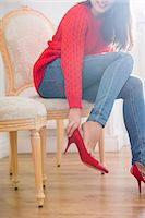 Low section of woman trying on footwear in store Stock Photo - Premium Royalty-Freenull, Code: 693-07542269