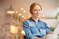 Woman holding menu in cafe Stock Photo - Premium Royalty-Freenull, Code: 6113-07542415